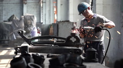Chinese worker are repairing machine parts in factory - stock footage