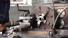 Chinese worker operating on a lathe machine Stock Footage
