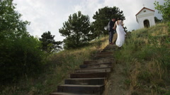Wedding Couple Climb Stairs - 4k - Slow Motion Stock Footage