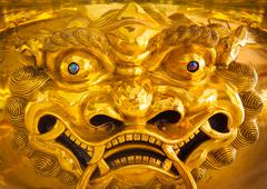 Chinese dragon golden statue close up - stock photo