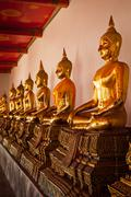 Sitting Buddha statues, Thailand - stock photo