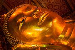 Reclining Buddha face - stock photo