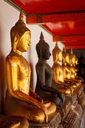 Sitting Buddha statues, Thailand - stock photo
