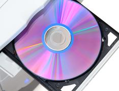 Computer with dvd in open tray - stock photo