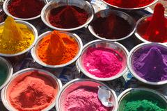 Colored colorful powder kumkum on Indian bazaar for holi festival celebration Stock Photos