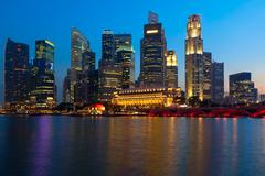 Singapore skyline and river in evening Stock Photos