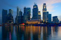 Singapore skyline and Marina Bay in evening Stock Photos