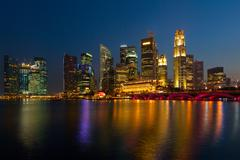 Singapore skyline and Marina Bay in evening - stock photo