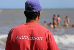 Stock Photo of Lifeguard and the red Jersey with RESCUE written in italian