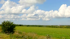 Panorama of endless fields and clouds. Pastoral rural landscape. - stock footage