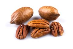 Few pecan nuts isolated on white Stock Photos