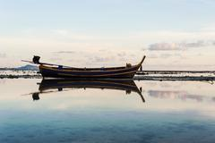 Fishing boat in the sea with morning light - stock photo