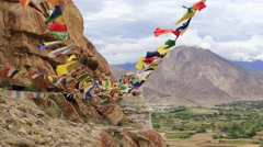 Colorful Buddhist prayer flags near tibetan monastery in Ladakh, India Stock Footage