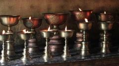 Icon-lamps in tibetan monastery of Lamayuru, Ladakh, India Stock Footage