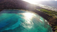Aerial of Hanauma Bay during late afternoon Stock Footage