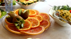 Oranges and kiwi on a plate. Stock Footage