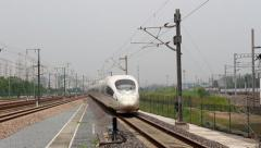High speed bullet train driving on the railway, towards the camera lens - stock footage