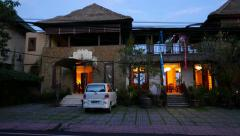 Balinese luxurious suite entrance building in dusk, slide-panning shot Stock Footage