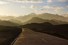 Road and mountain range in Gansu province, China Stock Photos