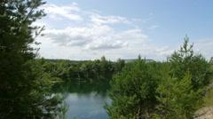 Turquoise lake form phosphorite quarry Stock Footage
