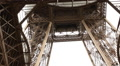 Tourist stepping in a panoramaic glass in the Eiffel tower HD Footage