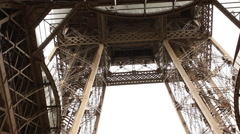 Tourist stepping in a panoramaic glass in the Eiffel tower - stock footage