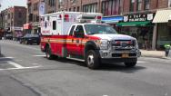 Stock Video Footage of Ambulance Racing Down New York City Street
