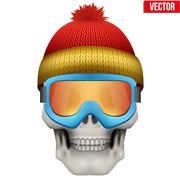 Vector Human skull with winter hat and goggles - stock illustration