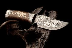 Ornamental hunting knife. - stock photo