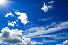 Cumulus clouds in blue sky - stock photo