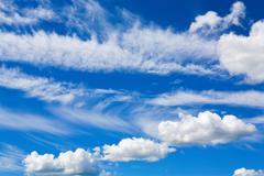 Stock Photo of Cumulus clouds in blue sky