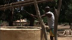 Farmer in casamance in full bush Africa Stock Footage
