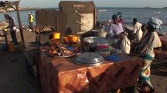 Fishmonger on the beach from Dakar to Senegal in Africa Stock Footage