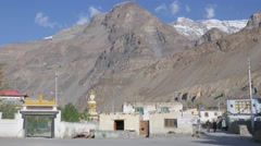 Entrance to Tabo Monastary with 2 men passing,Tabo,Spiti,India Stock Footage