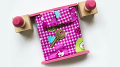 House key on a toy bed. Stock Footage