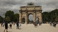 Stock Video Footage of People walking in front of the Arc de Triomphe du Carrousel, Paris