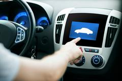 Male hand pointing finger to car icon on panel Stock Photos