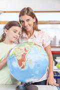 Stock Photo of woman teaching geography.
