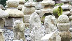 Stone Buddhaist statue tomb in Japanese shrine Stock Footage