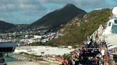 Sint Maarten 108 sail-away from Philipsburg harbor with island landscape Stock Footage
