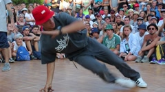 A breakdancer performing Footwork. Stock Footage