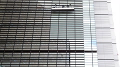 Cleaning The Windows of a Modern Glass Skyscraper Office Buildin Stock Footage