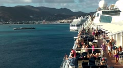 Sint Maarten 115 set sail; cruise ship turns along island landscape Stock Footage