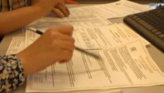 Notary and clients check, juridical legal certifies the documents - stock footage