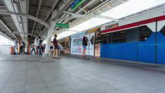 Timelapse People standing in lines waiting for BTS sky train in Bangkok Thailand Stock Footage
