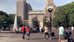 Summer scenery in Washington Square Park NYC, tilt down Stock Footage