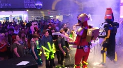 A band dress up as robots performing in front of a crowd in a night club Stock Footage