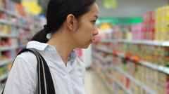 Asian girl, woman shopping snacks in supermarket Stock Footage