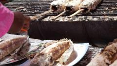 Fresh Whole snakehead fish roasted grilled with salt on burning charcoal Stock Footage
