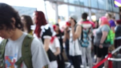 Out of focus long line of people waiting inside convention centre Stock Footage